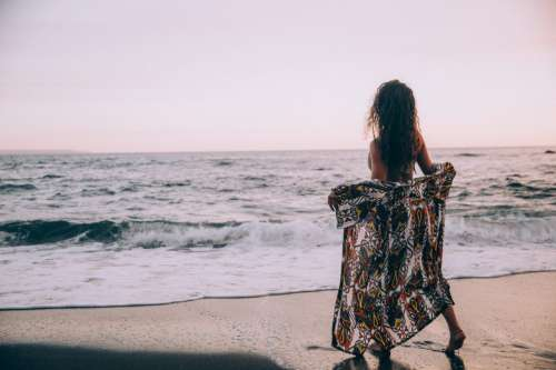 Woman Beach Sunset