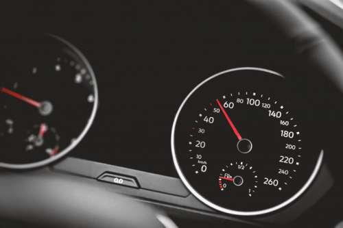 Close up shot of a speedometer in a car