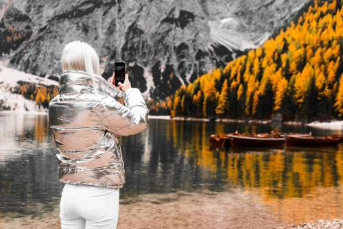 Woman Taking a Photo of Braies Lake in Italy Free Photo