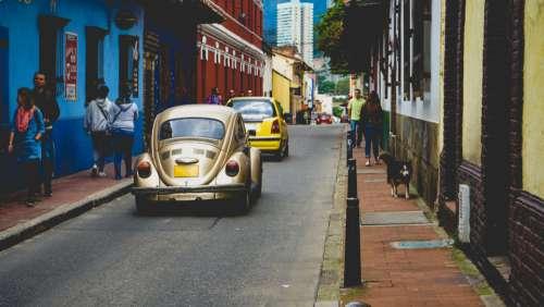 cars urban street pedestrians people