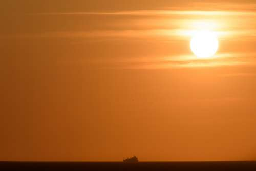 ocean sunset ship sea boat
