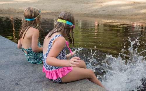 kids lake water splashing playing