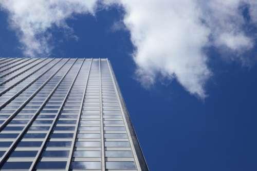 city building windows sky clouds