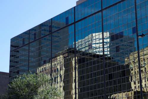 glass building reflection architecture city