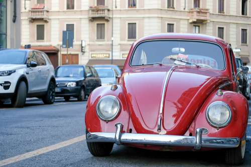 Parked Red Volkswagen Beetle