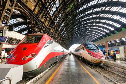 Two Fast Trains in a Train Station