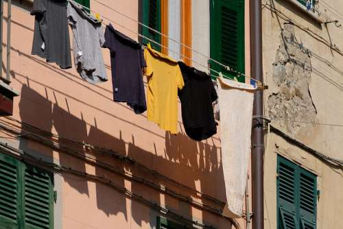 Clothes Left to Dry Hanging in Front of the Balcony