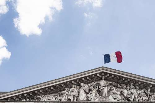 French Flag On Top Of Building Photo
