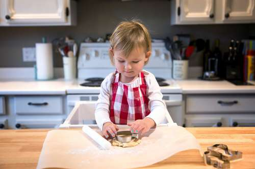 Child Makes Cookies Photo