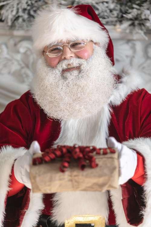 Smiley Santa Presents A Gift Photo