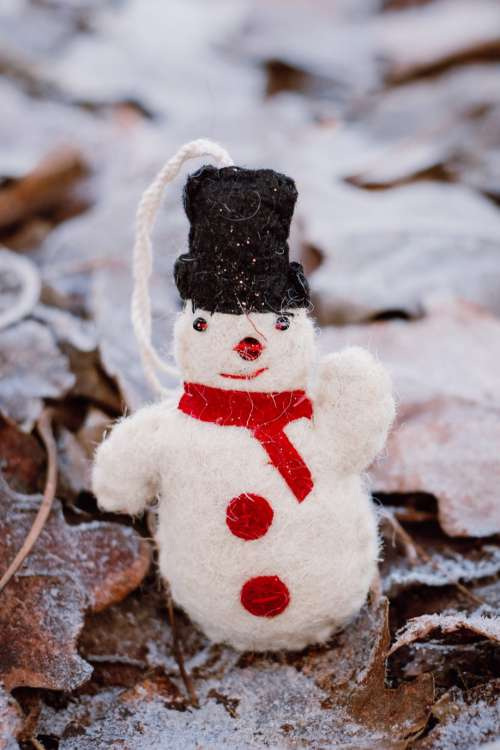 Felted snowman on frosted leaves 5