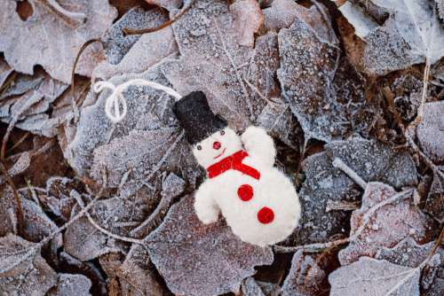 Felted snowman on frosted leaves 3