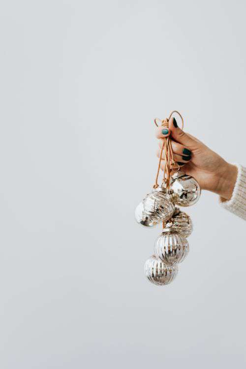 Hand Holding Christmas Tree Baubles