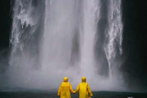 Couple Holding Hands People Raincoat