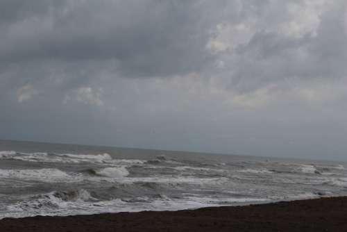 Waves Crashing In On Shore