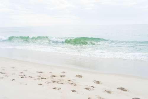 beach sand waves wet ocean