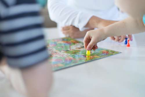 playing game kids table hands