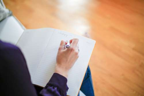writing hand note pen paper
