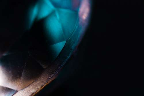 Blue Light Shimmers On A Gemstone Photo