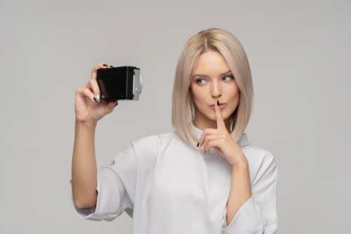 Young Attractive Woman Holding Vintage Camera Like Doing Selfie