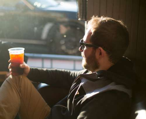 man drinking coffee urban restaurant