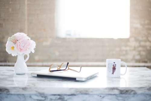 desk flowers office laptop cup