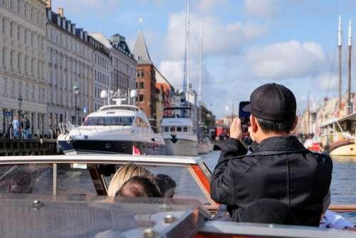Tourist Taking Photos on Copenhagen Canal Tour