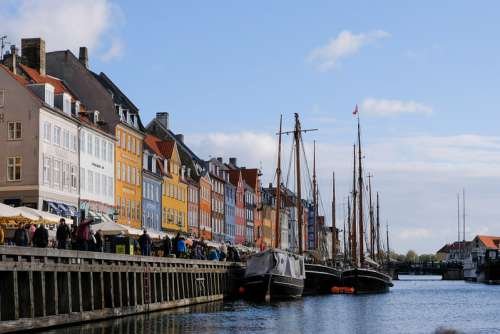 Boats on Copenhagen Canal With Colorful Buildings Behind