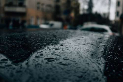 Rain Drops On A Car Photo