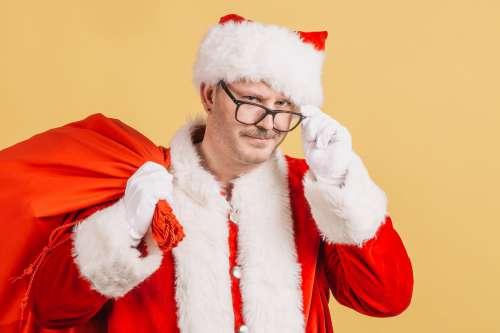 Santa Pulls Cap Photo
