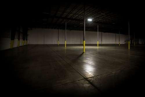 Dimly Lit Empty Warehouse Photo