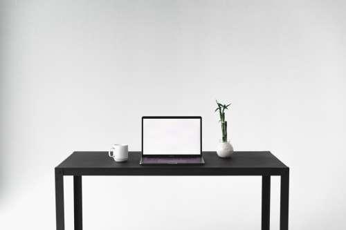 Front Facing View Of Minimal Desk Setup Photo