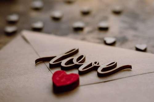 Wooden word love on a beige envelope