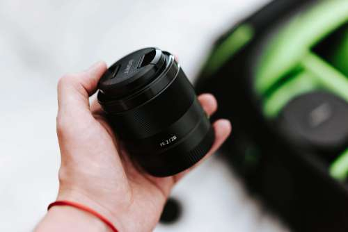 Sony 28mm f2 Lens and a Camera Bag Free Photo