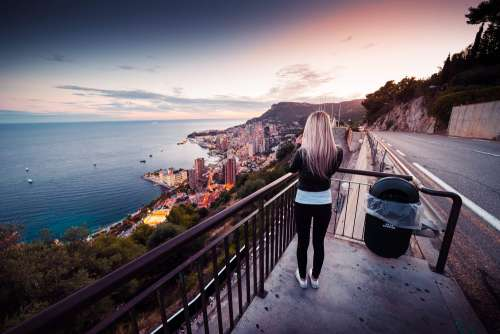 Young Woman Taking a Picture of Evening Monaco Free Photo