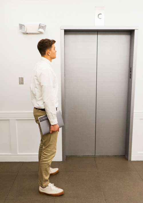 elevator building person waiting man