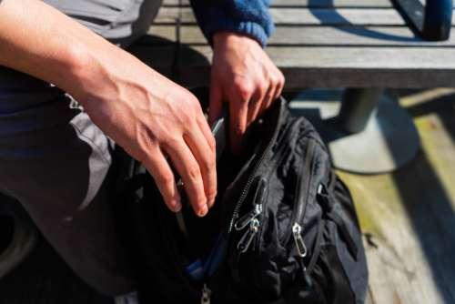 hands backpack travel bag close up
