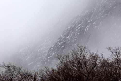 snow rock cliffs winter ice