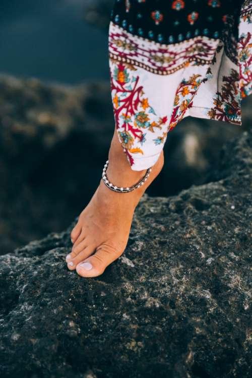 female foot fashion rocky shore