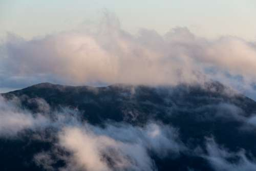 clouds mountain landscape wispy sky
