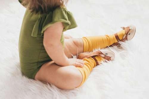 Child Sits On Fluffy Rug Photo