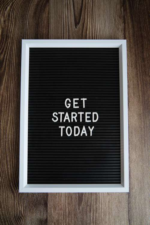 Get Started Today On Dark Wood Background Photo