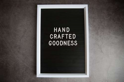 Handcrafted Goodness Sign On Stone Photo