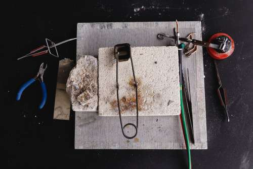 Tools And Brick On Workbench Photo