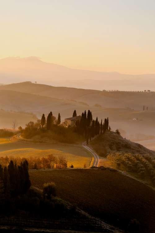Golden Sunset Over Rolling Hills Photo