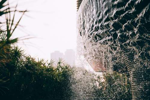 Water Ripples Down The Side Of A Fountain Photo