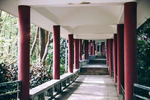 Red Pillars Line A Walkway Photo