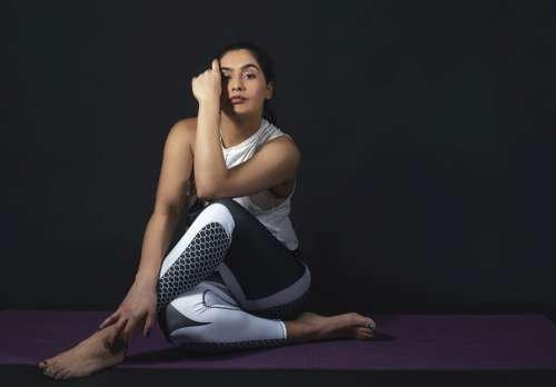 Woman Sits On Purple Mat Photo