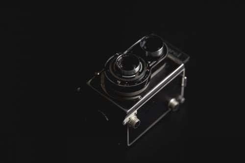Vintage Camera Against Black Photo