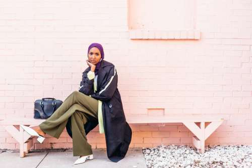 Model Rests On Bench Showing Off Her Spring Style Photo